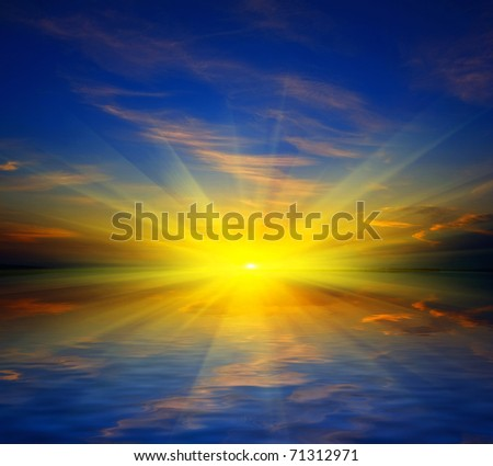 Sunset over water surface of lake