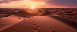 Sunset panorama in the desert. Dunes Erg Chebbi in the Sahara desert near Merzouga, Morocco , Africa. Beautiful sand landscape with stunning sky.