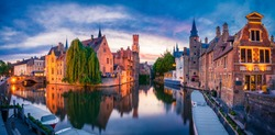 Sunset panorama of center of Bruges, often referred to as The Venice of the North, with famous Rozenhoedkaai. Belgium