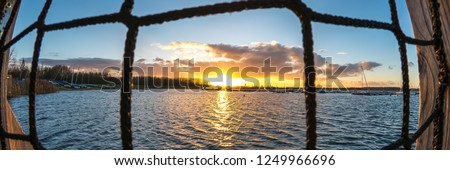 Sunset panorama of the harbour of the Cospudener Lake near Leipzig, Germany  #1249966696