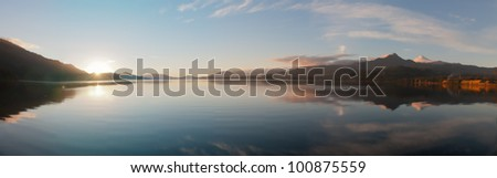 Sunset Panorama on the Co���±aripe city lake and reflection of the Villarica Volcano (Chile)