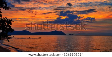 Sunset panorama over the beach in Thailand with Sattahip mountains in background near Bang Saray, Chonburi #1269901294
