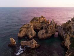 Sunset panorama view of Ponta da Piedade beach cape ocean sea stack rock formations in Lagos Algarve, Portugal Europe