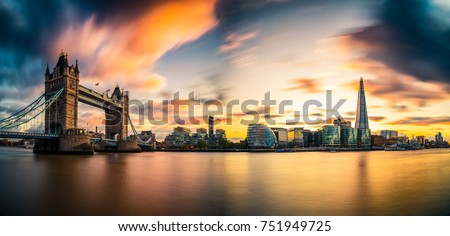 Sunset panorama with Tower Bridge and blurry sky  #751949725