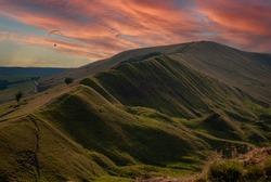 Sunset paragliding above Mam Tor by Castleton in Hope Valley, Peak district, UK