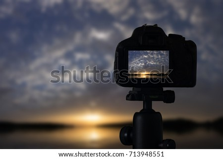 Sunset photography. Camera with tripod Sunset. Sunset.