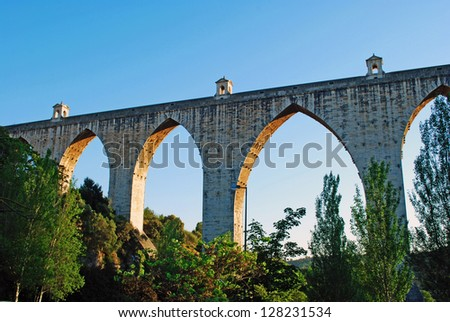 sunset picture of the historic aqueduct in the city of Lisbon built in 18th century, Portugal