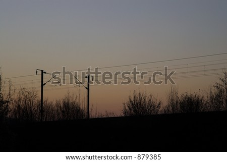 Sunset railroad wires.