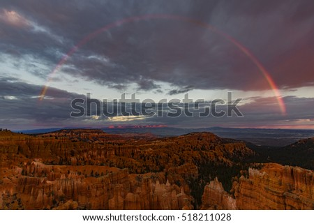 Sunset Rainbow at Sunset Point - Full rainbow over Bryce Canyon amphitheater as seen from Sunset Point, Bruce Canyon National Park, Utah.