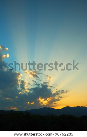 Sunset Rays over Hills