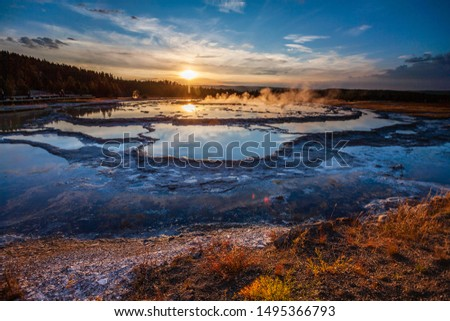 Sunset reflected in the pools of Great Fountain Geyser, Yellowstone National Park, WY  #1495366793