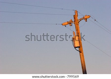 Sunset Reflected on a Telephone Pole