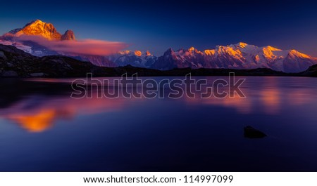 Sunset reflection in a lake in the Mont Blanc Mountains