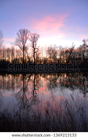 Sunset reflection in calm, clear water - Calmness, quality time, nature concept #1369213133