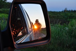 sunset reflection in the mirror of the machine