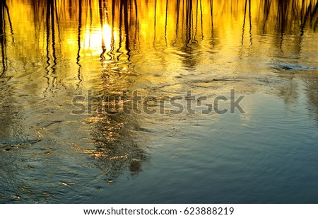 Sunset reflection in water. Reflects water sunset ripples