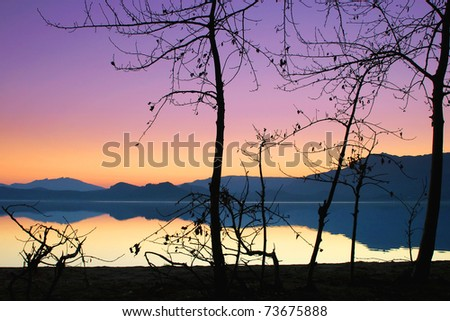 sunset reflection of the mountain around the lake