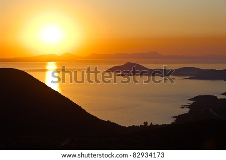 sunset reflection on greek sea