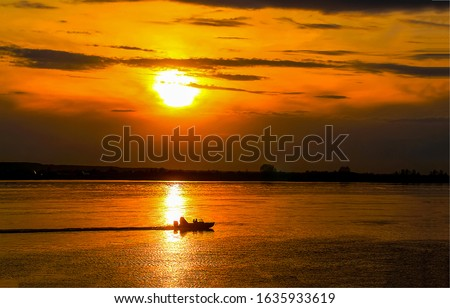 Sunset river boat silhouette view. River boat sunset landscape
