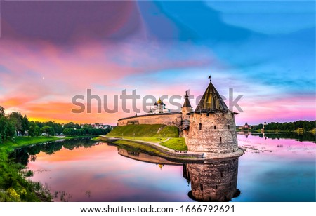 Photo of  Sunset river fortress tower landscape. River fortress sunset view. Fortress sunset river landscape. Sunset fortress on river