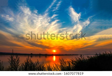 Sunset river horizon sky clouds. River sunset landscape. Sunset river view. Sunset river panorama