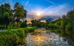 Sunset river reflection scenic landscape. Forest river sunset scene.