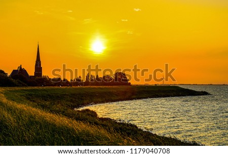 Sunset river shore silhouette landscape. River shore sunset silhouette panorama. Sunset river silhouette view. Sunset silhouette river scene