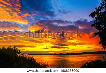 Sunset river sky clouds landscape. River sunset view. Rural river sunset sky clouds. Sunset river landscape