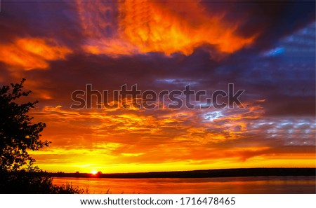 Sunset river sky clouds landscape. Sunset sky clouds over river water. Sunset river sky landscape
