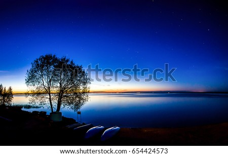 Sunset river star sky landscape. Sky stars night over river sunset