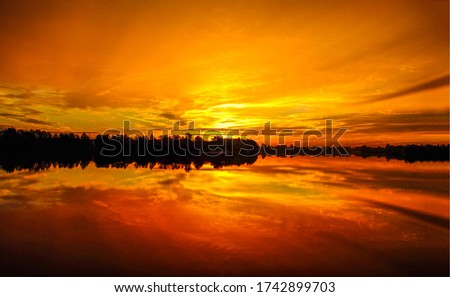 Sunset river water reflection landscape. Beautiful sunset river scene. River sunset view