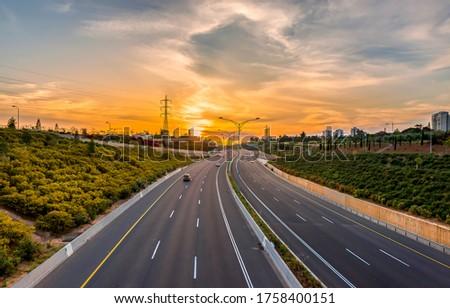 Sunset rural highway road landscape. Sunset highway road. Road in sunset