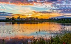 Sunset rural river dawn landscape. Village river sunset landscape.