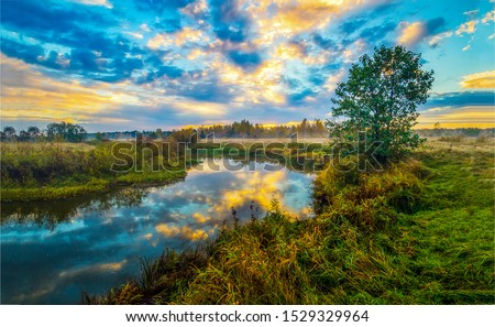 Sunset rural river sky clouds landscape. Rural river sunset landscape. Rural river sunset fod landscape. Sunset river fog landscape