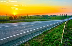 Sunset rural road landscape. Rural road sunset scene