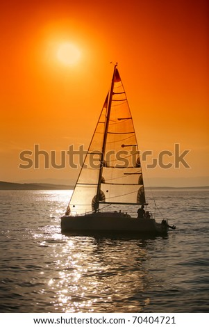 Sunset sailing - stock photo