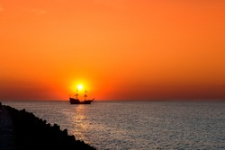 sunset - sailing ship silhouette on the sunset background