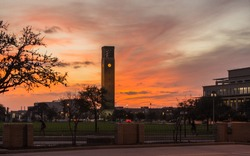 Sunset scene in Aggie land with bell tower icon
