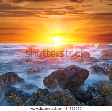 Sunset scene on sea coast - stock photo