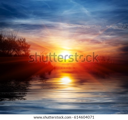 Sunset scene over lake water surface #614604071