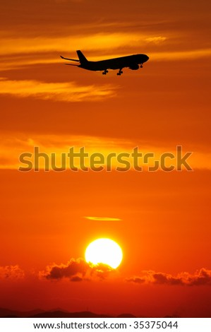 Sunset scene with airplane silhouette - stock photo