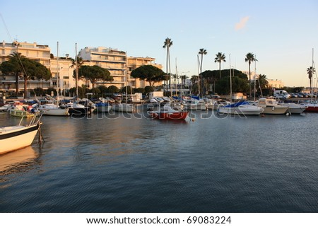Sunset scene with boats on the sea ( Cannes France )