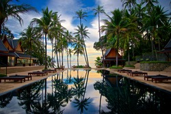Sunset Scenery On The Swiming Pool With Reflection And Coconut Forest In Phuket In Thailand