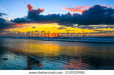 Sunset sea horizon sky clouds landscape. Sunset cargo ship horizon silhouette landscape. Sunset sea cargo ship view. Sunset sea horizon landscape