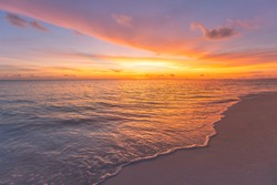 Sunset sea landscape. Colorful ocean beach sunrise. Beautiful beach scenery with calm waves and soft sandy beach. Empty tropical landscape, horizon with scenic coast view. Colorful nature sea sky