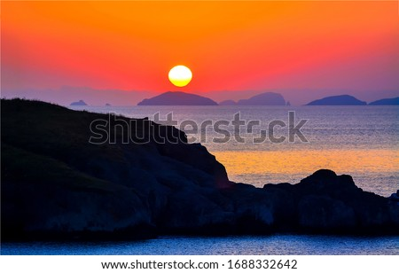 Sunset sea rock horizon view. Sea rock sunset silhouette. Sunset sea rock. Sunset sea rock landscape