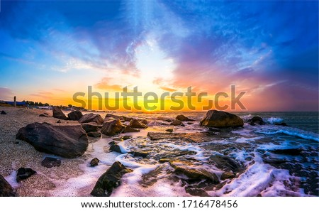 Sunset sea rocky beach landscape. Rocky sea beach sunset view. Sunset sea beach rocks landscape. Sunset sea beach scene