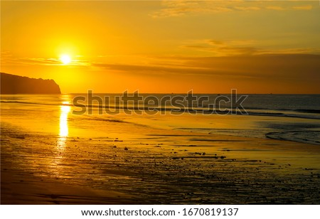 Sunset sea sand beach landscape. Sunset beach horizon. Sea sand sunset beach horizon panorama. Sunset beach landscape