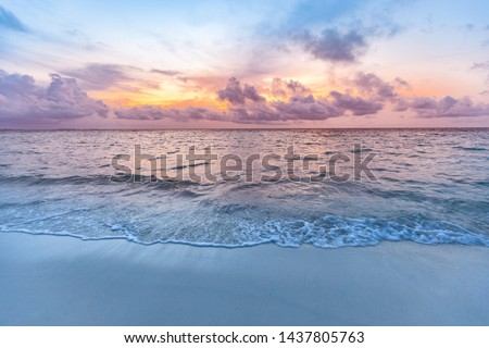 Sunset sea sand sky. Beautiful beach nature, soft sunlight and splashy waves cloudy colorful sky with sunlight. Tranquil beach landscape, calmness and inspiration view. Ocean water ecology concept Сток-фото ©