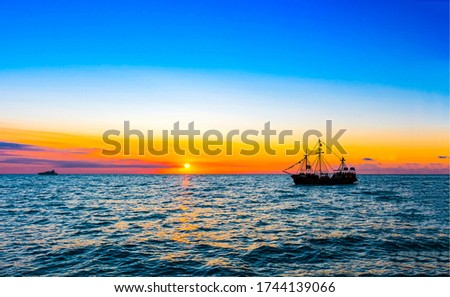 Sunset sea ship silhouette view